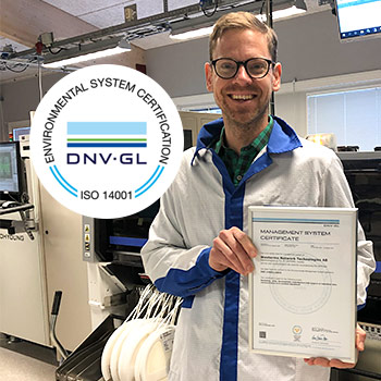 Westermo's quality manager Oscar Eklund holding the ISO 14001 certificate.